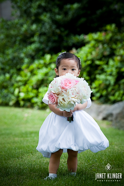 Filipino flowergirl holding wedding flowers