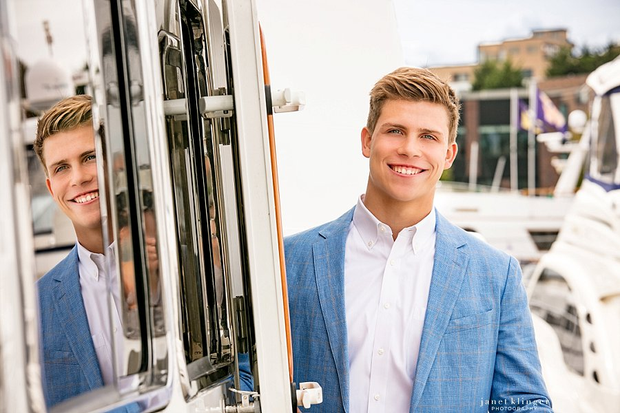 handsome inside and out, senior pictures on family boat in Seattle
