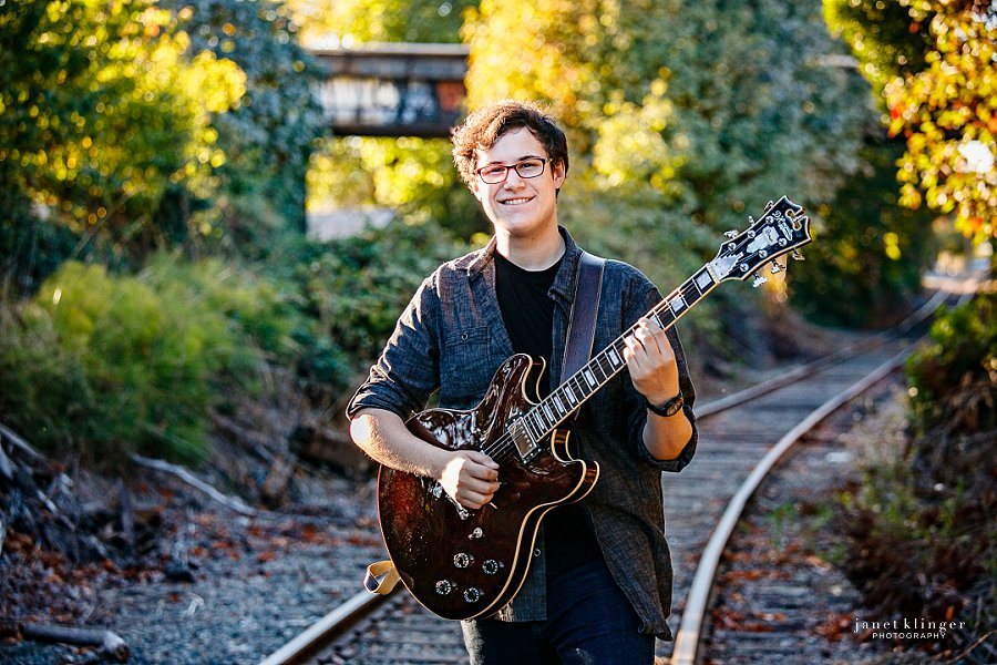 Guitar playing along railroad tracks in Seattle